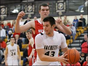 Perrysburg's Nate Patterson tries to maneuver around Bowling Green's Nolan Dill.