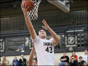 Perrysburg's Nate Patterson puts up a layup in front of Bowling Green's Nolan Dill.