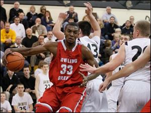 Bowling Green's Vitto Brown drives along the baseline against Perrysburg.
