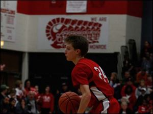 Bedford's Conner Hutchison looks down the court for the open pass.