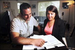 Richard and Susan Mallek, right, are first time homebuyers who expect to close on their new Boynton Beach home at the end of the month. Before the couple, who now live in Delray Beach, Fla., began their search last summer, they studied a homeowner's guide to buying real estate.