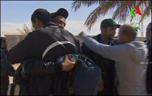 Rescued hostages hug each other  in Ain Amenas, Algeria, in this image taken from television on Friday.