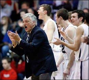 St. John's coach coach Ed Heintschel encourages his team en route to his 600th victory. He is now 600-189 in his career.