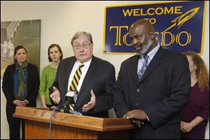 From left: Emily Avery, of United Way, Emily Hardcastle, with UT, UT President Dr. Lloyd Jacobs, Toledo Mayor Mike Bell and UT's Cindy Tierney attend a press conference at the mayor's office today to announce Monday's