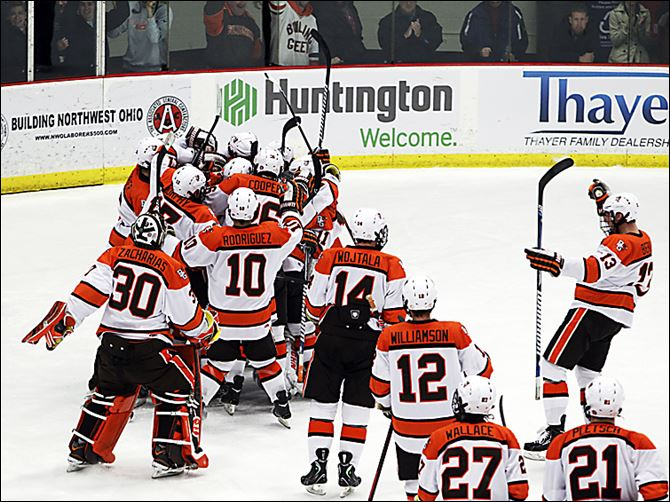 Bowling Green players mob goalie Andrew Hammond after the Falcons defeated No. 10 Western Michigan 3-2 on Friday. The Falcons are on a six-game unbeaten streak.