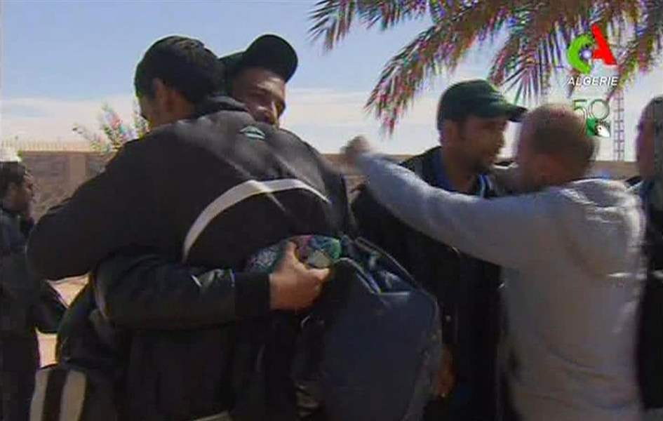 Rescued-hostages-hug-each-other-in-Ain-Amenas