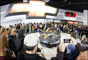 The 2014 Corvette Stingray proved to be the main attraction during the first day of the auto show. A crowd encircled it, hoisting smart phones to snap photos and waiting to get a closer look at the impressive sports car.