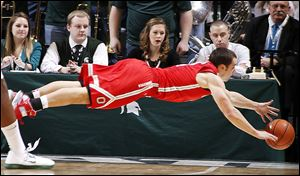 Ohio State's Aaron Craft dives for a loose ball during the first half against Michigan State.
