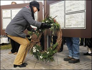 Alma Moore-Egen, a descendant of the Navarre family, lays a wreath at the battlefield's visitor center. About 30 members of the Navarre family fought in the battles.