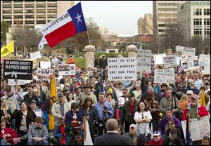 Hundreds attend a Guns Across America pro-Second Amendment rally today at the state Capitol in Austin, Texas.