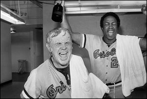 Baltimore Orioles manager Earl Weaver, left, is soaked with champagne after the Orioles defeated the California Angeles 8-0 to win the American League championship, in Anaheim, Calif.