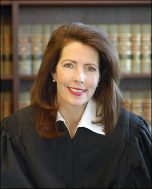 Diane M. Hathaway, of the Michigan Supreme Court, is resigning Monday, months after a series of questionable real estate transactions first were revealed by a Detroit TV station.