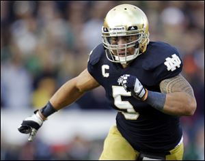 Notre Dame linebacker Manti Te'o chases the action during the second half of an NCAA college football game against BYU in South Bend, Ind.