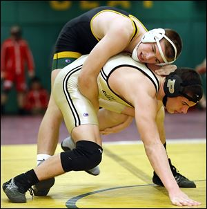 Matt Stencel of Clay controls Kadin Llewellyn of Perrysburg in the 182-pound championship match at the Michael Casey Memorial Classic wrestling tournament at Clay. Stencil pinned the top-seeded Llewellyn.