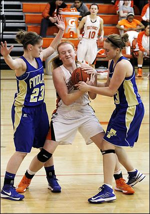 Findlay's Jacey Hardesty, left, and Abby Smarkel force a jump ball with Southview's Emily Westphal. The Trojans improved to 11-3. Southview is 11-5.