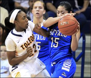 UT's Andola Dortch, who had 20 points, guards Buffalo's Margeaux Gupilan in Saturday's game at Savage Arena. The Rockets improved to 15-2, 3-1 in the Mid-American Conference.