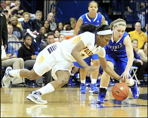Toledo's Lucretia Smith, who had nine rebounds and six assists while scoring four points, steals the ball from Buffalo's Nicki Hopkins late in the second half of a Mid-American Conference game at Savage Arena.