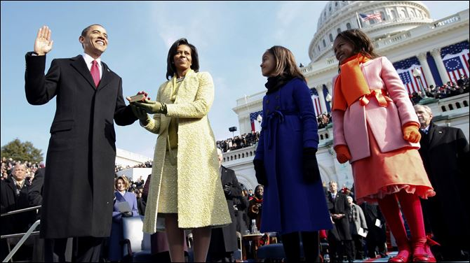 Inauguration Moments Barack Obama, left, takes the oath of office from Chief Justice John Roberts, not seen, as his wife Michelle, holds the Lincoln Bible and daughters Sasha, right and Malia, watch at the U.S. Capitol in Washington.