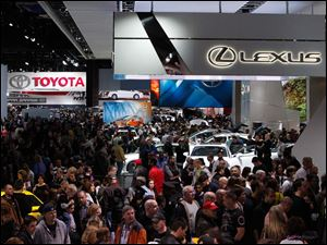 The floor is packed during the first public day of the North American International Auto Show.