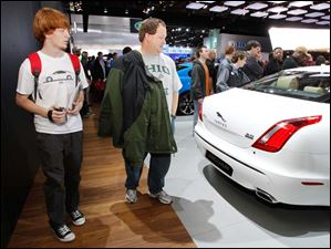 Trevor Heim, 18, of Maumee, and his father Scott Heim check out the latest offerings from Jaguar.