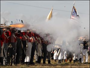 Guns are fired to kick off the 200th anniversary of the Battles of the River Raisin re-enactment.