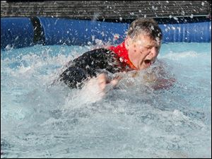 Mike Faylor of Point Place reacts to hitting the water.