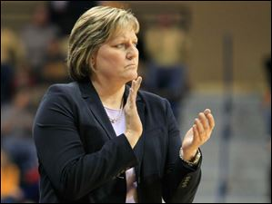 UT coach Tricia Cullop applauds after Brianna Jones scores two points.