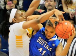 A Toledo player battles a Buffalo player for the ball.