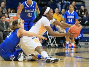 UT's Lucretia Smith steals the ball from Buffalo's Nicki Hopkins.