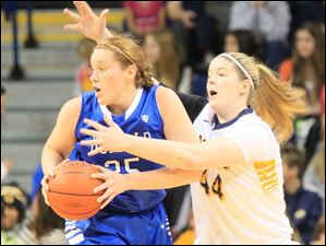 Buffalo's Kristen Sharkey is defended by UT's Kyle Baumgartner in the first half.