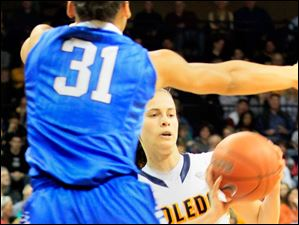 Toledo's Naama Shafir looks to pass around a Buffalo defender.