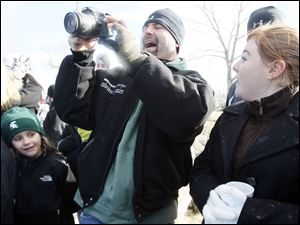 Schon LaBell, center, takes a picture of his daughter taking the plunge.