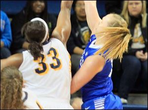UT's Yolanda Richardson blocks the shot of Mackenzie Loesing at the beginning of the second half.