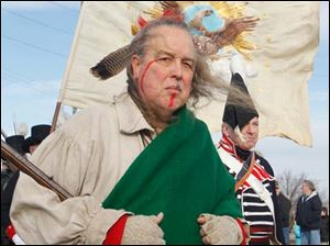 Rusty Cottrel, of Springfield, Ohio, dresses as a Peckuwe Shawnee.