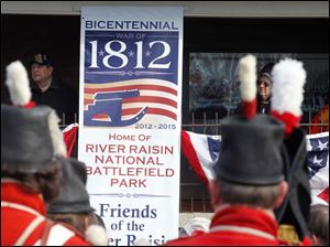 A sign marks the 200th anniversary of the Battles of the River Raisin at the River Raisin National Battlefield Park Visitor Center in Monroe, Mich.
