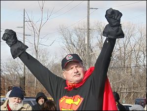 Mike Faylor of Point Place holds his arms up in the air to pump up the crowd. Faylor said that this was on his