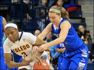 UT's Lucretia Smith, who had nine rebounds and six assists while scoring four points, steals the ball from Buffalo's Nicki Hopkins late in the second half.