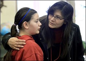 Maegan Pete, 11, is consoled by her mother, Tracie Pete, after she misspelled a word several rounds into the sixth-grade spelling bee at Bedford Junior High School. It lasted more than a dozen rounds.