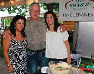 Karyn and Labib Hajjar, here with their daughter Marie Hajjar Russel, right, are among the many community leaders who put in much time and effort to benefit the area.