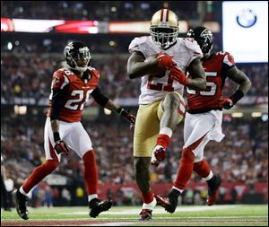 San Francisco 49ers running back Frank Gore breaks away for a nine-yard touchdown run during the second half of the NFC championship game against the Falcons on Sunday in Atlanta. Gore ran 21 times for 90 yards and two scores as the 49ers won 28-24, advancing to their first Super Bowl since January, 1995.