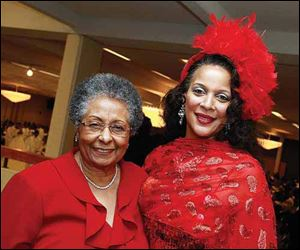 Wilma Brown, left, and Denise Blackpoon at the 48th Annual Debutante cotillion presented by the Toledo Club of the National Association of Negro Business and Professional women's Clubs, Inc. at Stranahan Great Hall.
