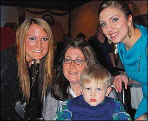 Committee members Megan Martinek, left, and Bethanie Cherry, right, pose for a photo with Melissa Belcher and her son Aden at the Miracles 4 Melissa Fund-raiser. The event raised money for Mrs. Belcher who is in the mid to late stages of Lou Gehrig's disease.