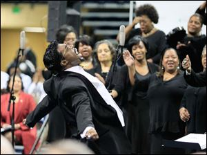 Derrick E. Roberts, left, leads the Toledo Interfaith Mass Choir during the 2013 Martin Luther King, Jr. Unity Celebration at the University of Toledo. This year's theme was