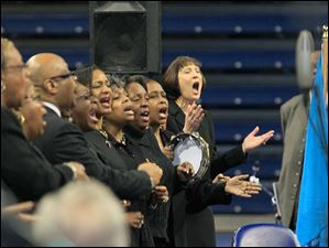 Members of the Toledo Interfaith Mass Choir perform.