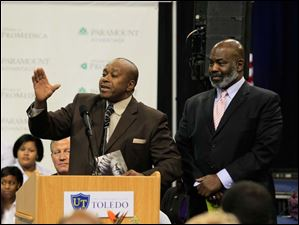 Tommy Hutton, left, and Toledo Mayor Mike Bell. Hutton attended to pick up an award for his brother, Johnny Hutton. Johnny Hutton is in Washington, D.C., escorting his sister, State Sen. Edna Brown (11th district), to the inauguration.