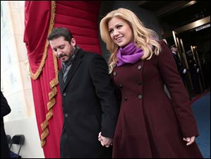 Singer Kelly Clarkson and Brandon Blackstock arrive on the West Front of the Capitol in Washington.