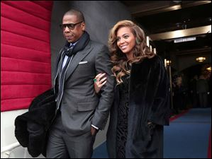 Recording artists Jay-Z and Beyonce arrive on the West Front of the Capitol in Washington.