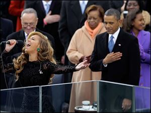 President Barack Obama as Beyonce sings the National Anthem at the ceremonial swearing-in.