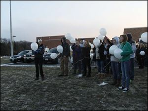 Friends begin to release ballons for Morgan.