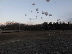 Balloons float in the sky for Morgan.